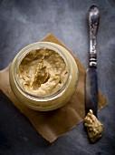 Jar of homemade chunky peanut butter.