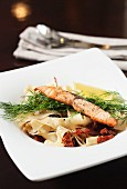 Ribbon pasta with salmon and sundried tomatoes