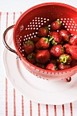 Freshly washed strawberries in a colander