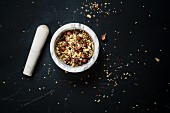 Egyptian dukkah spice mix with nuts in a mortar
