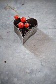 Blackcurrants and redcurrants in a heart-shaped cutter