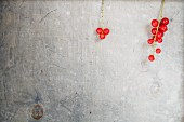 Redcurrants on white-glazed wood