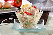 Russian salad with potatoes, tuna, egg, vegetables and mayonnaise