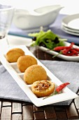 Bombas de patata y carne (fired potato dumplings filled with meat)