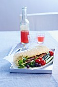 Wrap with a beef skewer, cherry tomatoes and olives