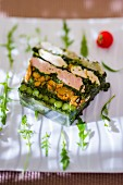 Fish terrine with spinach, beans and rocket