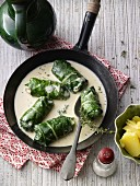 Capuns (stuffed chard leaves, Graubünden) in white sauce with a side of potatoes