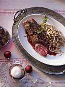 Saddle of venison fillet with hazelnut Spätzle (soft egg noodles from Swabia) for Christmas