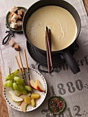 Cheese fondue with fruit and diced bread