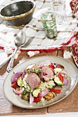 Couscous with vegetables and pork tenderloin