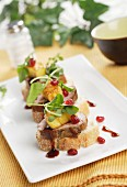 Canape pork tenderloin with pineapple and raspberry vinegar