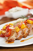 Detail sour pork tenderloin with peppers and rice