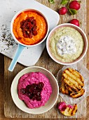 Beetroot dip, pea dip and pepper dip