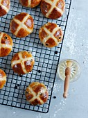 Hot cross buns on a wire rack