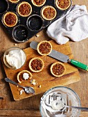 Mini pecan pies with cream