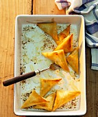 Filo pastry parcels in a baking dish