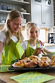 Two Scandinavian girls baking, Sweden.