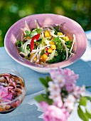 Vegetable and fruit salad in bowl, close-up