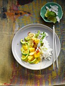 Mango and banana curry with peppers and rice (Asia)