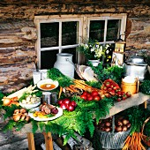 Fresh vegetables, dairy products and bread outside a farmhouse