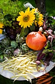 Summer vegetables and flowers on garden table (close-up)