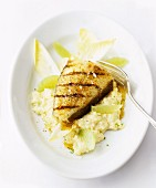 Grilled fish fillet on risotto with chicory