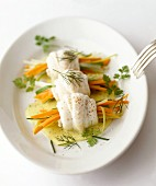 Rolled sole fillets with vegetables julienne and herbs