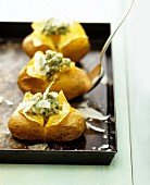 Baked potatoes with pesto and parmesan
