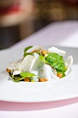 Spinach salad with rhubarb dressing, croutons and lardo