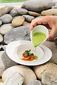 Watercress foam soup with a scallop and carrots
