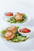 Scallops wrapped in bread, on baby spinach with tomato ragout