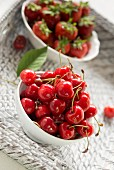 Cherries and strawberries in two bowls