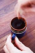 Woman stirring coffee