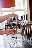 Bartender pulling beer