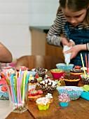 Girl decorating muffins
