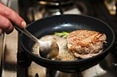 pan with butter and beef fillet