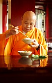 A monk eating