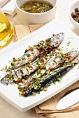Grilled mackerel with spicy sauce and capers, Italy