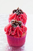 Christmas cupcakes with cherry & chocolate icing and silver balls