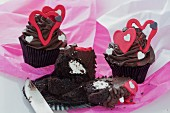 Dark chocolate cupcakes with red hearts, filled with buttermilk and sugar icing