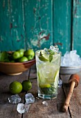 A Mojito and ingredients