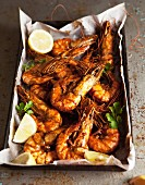 Oven-baked prawns on a baking tray