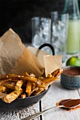 Chips with salt on grease-proof paper