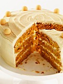 Carrot and nut layer cake, partly slices