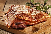 Roast belly pork on chopping board