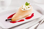 Pear poached in amaretto with cranberry sauce