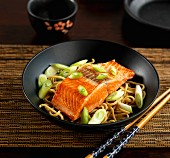sockeye salmon with egg noodles and spring onions
