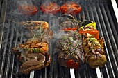 Skewers of beef, prawns and vegetables, on the barbecue