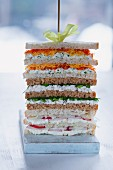 A stack of sandwiches on a skewer