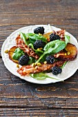 Spinach salad with bacon and blackberries